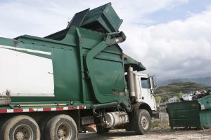 Dumptruck disposing of rubbish at a tip